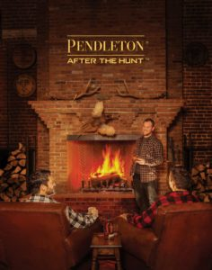 Image of Pendelton models, with logo and wearing flannel in front of fireplace
