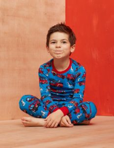 Image of young boy wearing pajamas, blue pattern, flannel