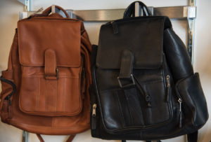 Image of two leather backpack bags, black and brown