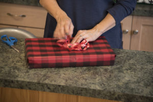 Holiday gift wrapping on gift box