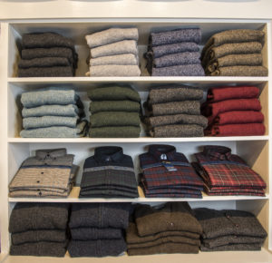 Classic men's sweaters and shirts on display