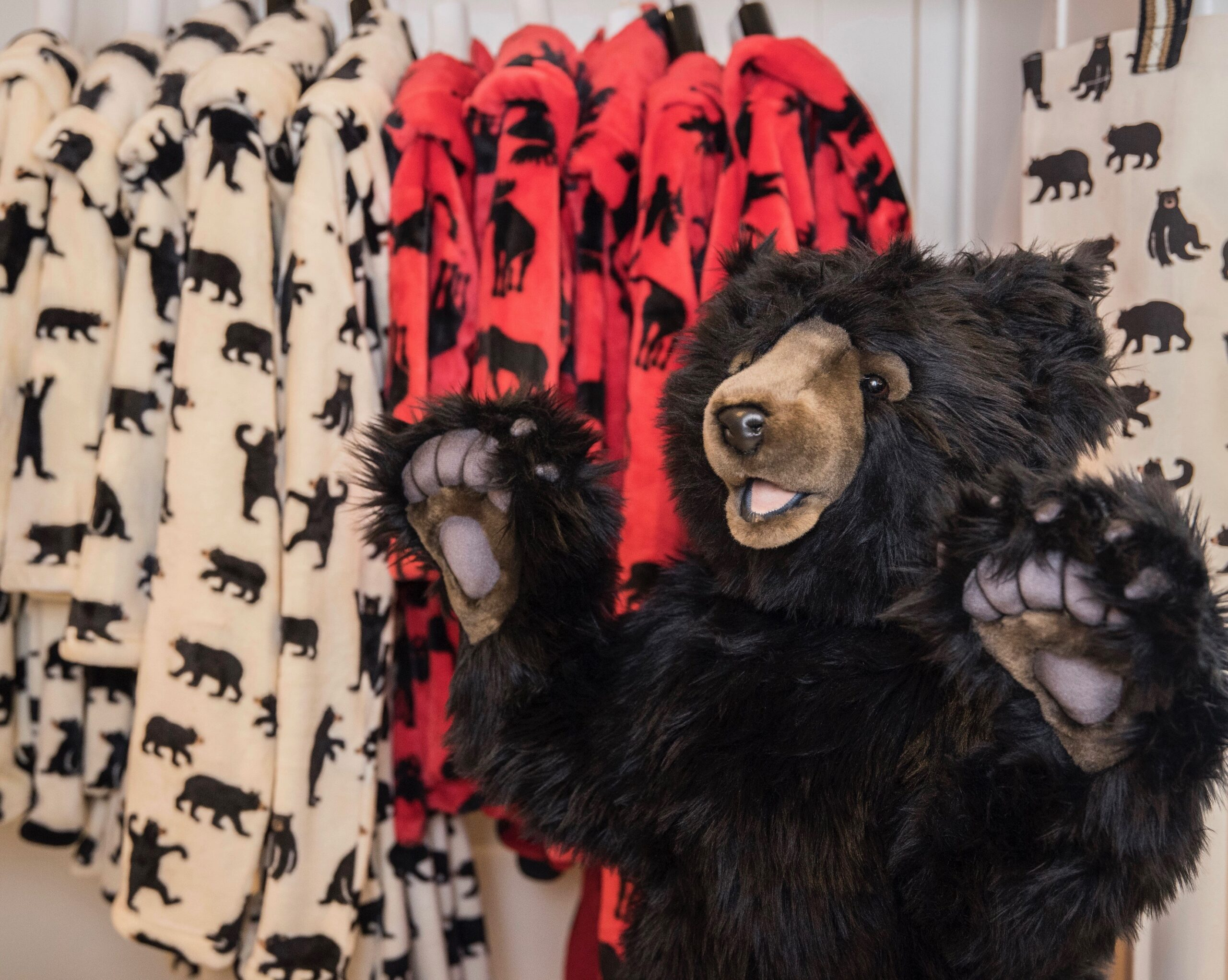 Kids flannel pajamas display with stuffed bear
