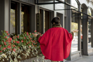 Model wearing red cape in Rhinebeck