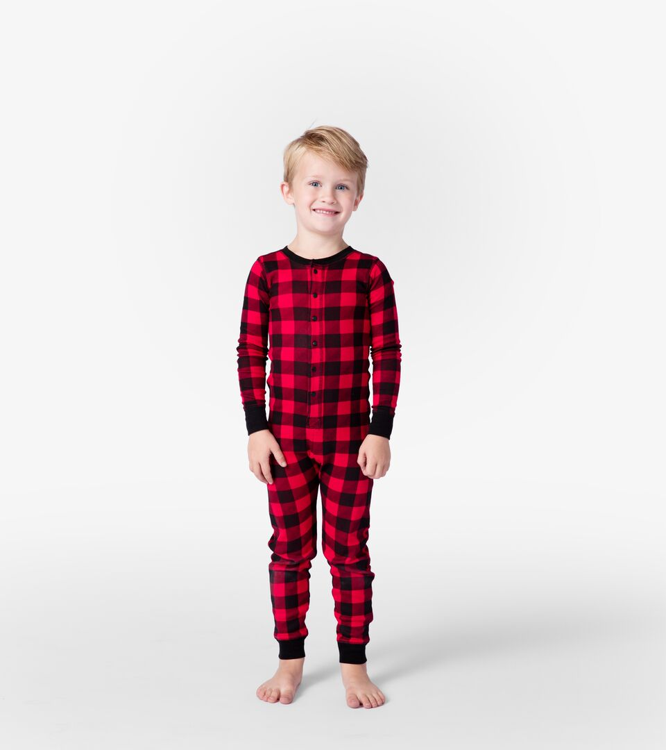 Image of youg boy in flannel pajamas