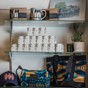 Display of gifts, including mugs, candles and bags