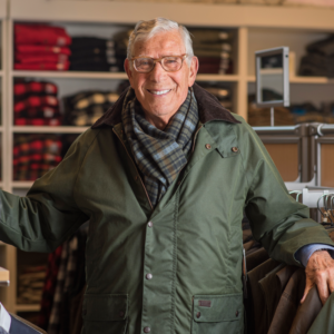 Image of Rhinebeck Department Store owner, Dick Schreiber wearing jacket and scarf