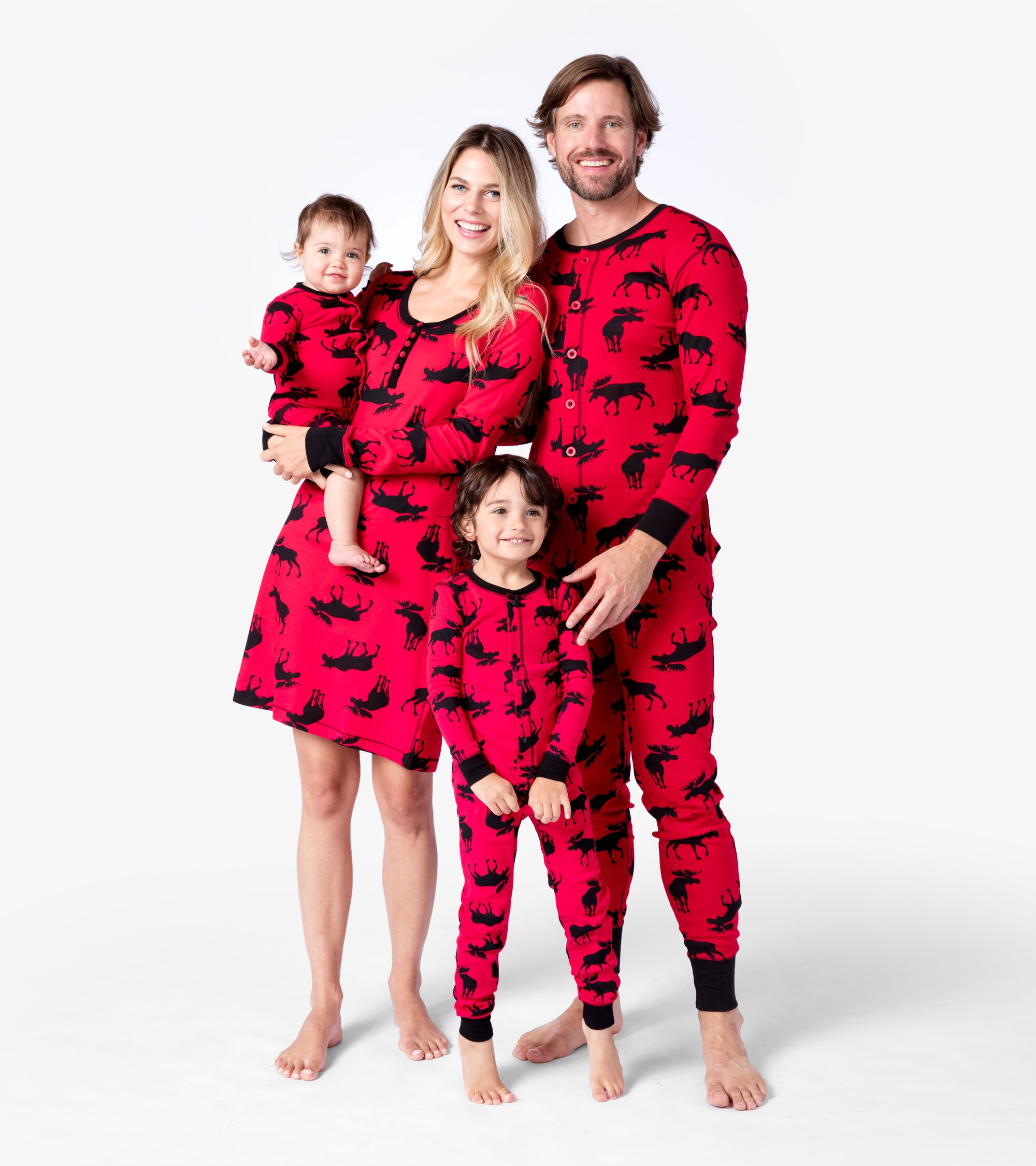 Image of family of four wearing flannel pajamas
