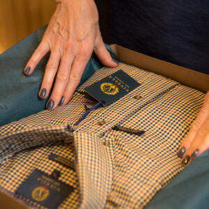 Men's shirt being prepared in gift box