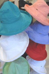 Image of ladies hats in pastel colors