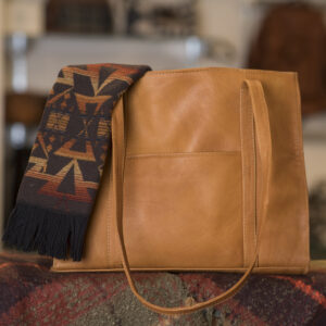 Image of leather handbag and earthy toned scarf
