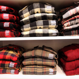 Image of Mens flannel shirts on shelves